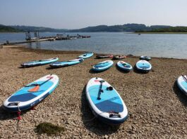Paddleboards by the shore of a reservoir
