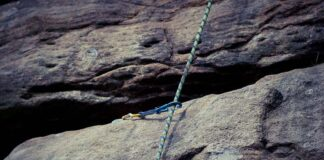 A climbing rope on bolted route