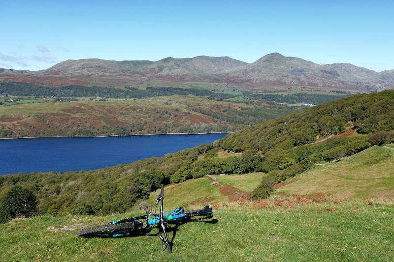 Mountain Bike with view of Coniston Water and fells.